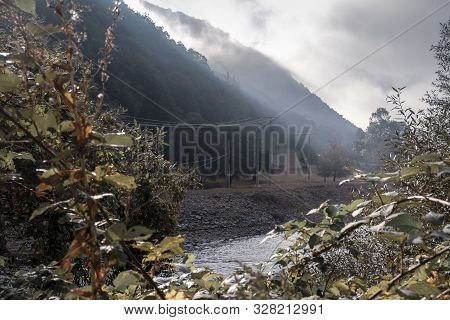 Autumn Scene With Dramatic Light On The Olt River