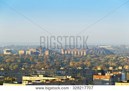 View Of The Heaps And Coal Processing Factory Over The Roofs Of Residential Buildings Of The Budenno