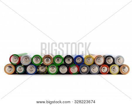 Old Aa Batteries Of Different Colors Are Stacked On Top Of Each Other. Batteries On White Background