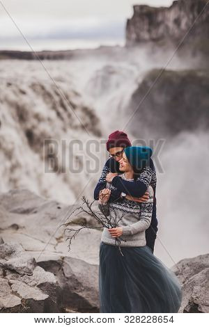 Close Up Lovely Portrait Of Young Hipster Couple Kissing Together Near Famous Icelandic Landscape -