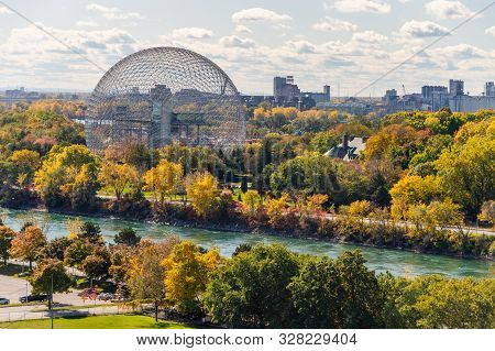 Montreal, Canada - 15 October 2019: Biosphere & Saint-lawrence River From Jacques-cartier Bridge In