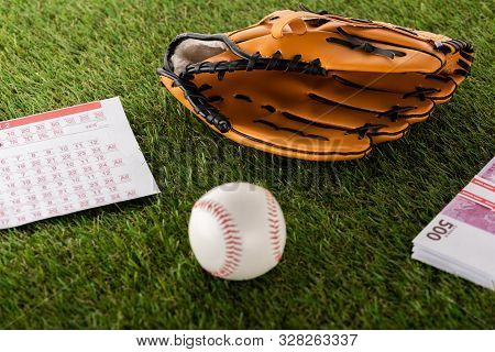 Baseball Glove And Ball Near Euro Banknotes And Betting List On Green Grass Isolated On White, Sport