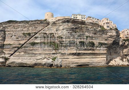 Incredible View Of Bonifacio Town In Corsica Island In France And The Long Stairway On The Rock