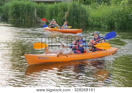 Two Men On A Kayak, Tourists Rafters In A Blue Boat, Matrosovka River, Polessky District, Kaliningra