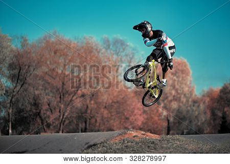 Moscow, Russia - Oct 17, 2019: Young Boy Jumping With His Bmx Bike At Pump Track. Bmx Race. Cyclist