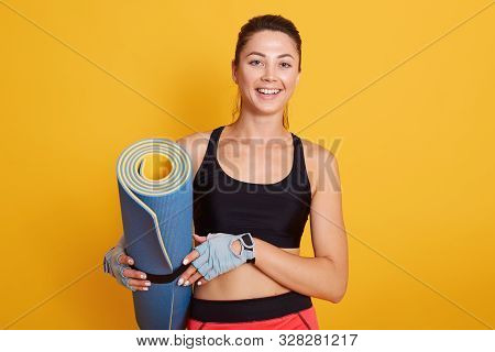 Close Up Portrait Of Exercise Fitness Woman Ready For Workout, Standing And Holding Blue Yoga Mat Is