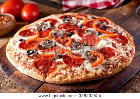 A Brick Oven Baked Pizza Deluxe With Pepperoni, Mushroom, Red Pepper, Onion And Black Olives Or A Ru