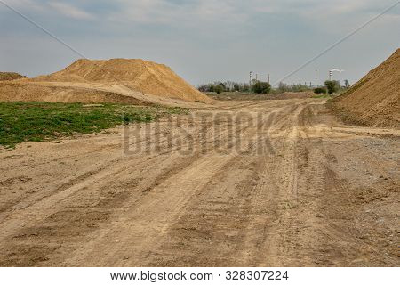 poster of excavator summarizes soil on construction site in dry summer season