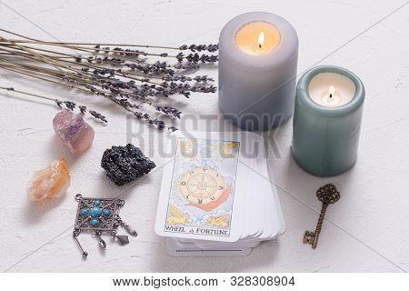 Kurgan, September 1, 2019: Wheel Of Fortune Tarot Card On White Stone Table Background.