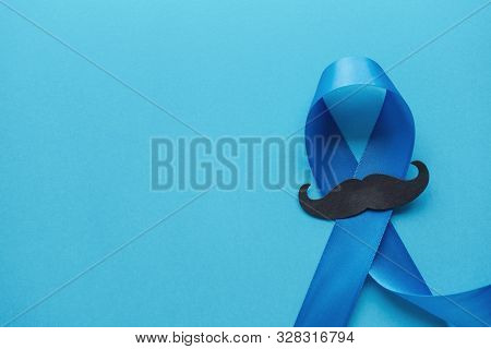 Light Blue Ribbons With Mustache On Blue Background , Prostate Cancer Awareness, Movember Men Health