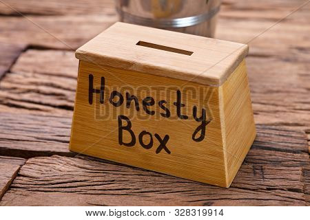 Photo Of Wooden Honesty Box On Wooden Table
