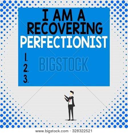 Handwriting text I Am A Recovering Perfectionist. Concept meaning Obsessive compulsive disorder recovery Isolated view young man standing pointing upwards two hands big rectangle. poster