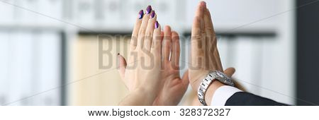 Happy Workers In Office Celebrating New Corporate Achievement By Giving Joint High Five In Air Close