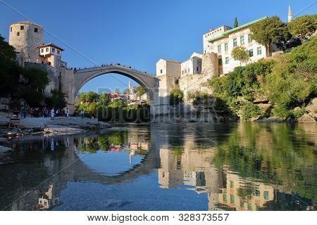 Mostar, Bosnia And Herzegovina - September 20, 2019: Reflections Of The Old Bridge (stari Most), Vie