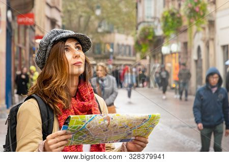 Traveler Woman With Map In Vacation. Woman Traveler In Vacation. Woman Traveling Alone With Map In V