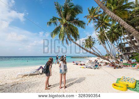 Maafushi Island, Maldives - November 17, 2017: People Enjoying Sunny Day In A Tropical Beach Of The