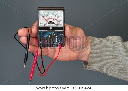 multimeter in a hand