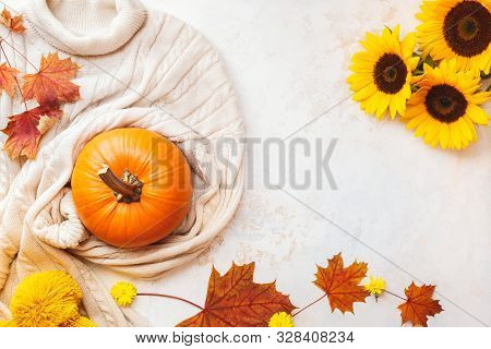 Autumn Flat Lay Background With  Pumpkin , Sweater And Golden Sunflowers On Wooden Table. Top View,