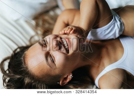 Young Mother Holding Her Child. Mom Nursing Baby. Nursery Interior. Mother Breast Feeding Baby. Fami