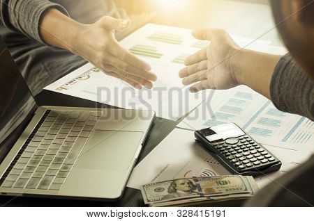 Businessman Gesture Shaking Hand  For Successful Dealing Negotiation. They Achieve  And Enjoy With M