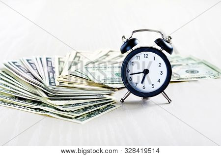 Business Financial Ideas Concept With Banknotes Stack And Alarmclock Isolate Background With Free Co