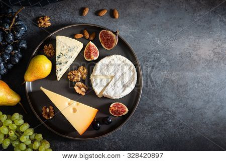Cheese Plate: Maasdam, Camembert Cheese, Blue Cheese, Figs, Walnuts, Almonds, Pears And Grapes On Th