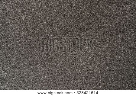 Black sandpaper textured background. Coated abrasive for making surface rougher poster