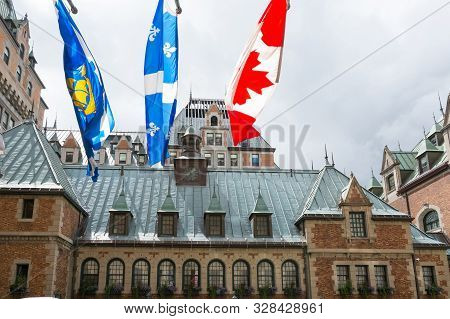 Quebec City, Canada - August 6, 2015:the Flag On The  Frontenac Castle In Quebec City A During A Clo