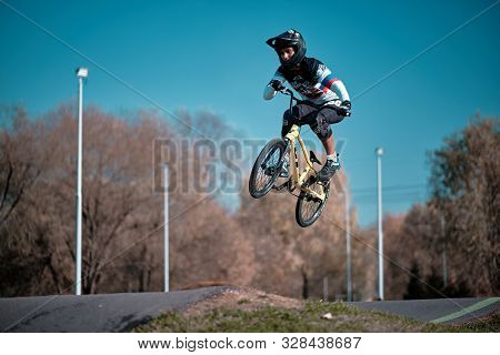 Moscow, Russia - Oct 18, 2019: Young Boy Jumping With His Bmx Bike At Pump Track. Bmx Race. Cyclist