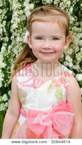 Portrait Of Smiling Cute Little Girl In Dress