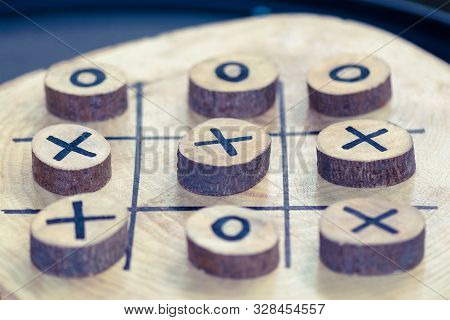 Wooden Game Tic Tac Toe. Focus Winner. Background With Blur. Business Thinking Winner. Creative Thin