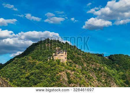 View Of Hilltop Castle On The Side Of Rhine River At Beautiful Summer Day In Germany. Rhine Valley I