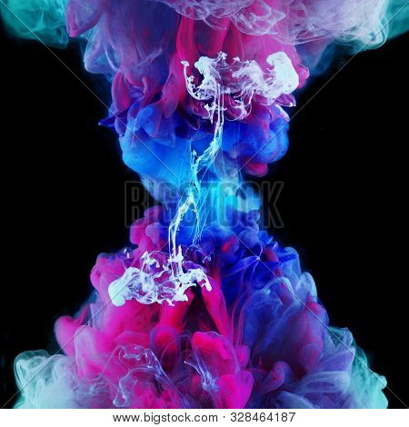 Explosion Of Color, Concept. Splashes Of Colored Ink In Water, Bright Colors. Creative And Color Mix