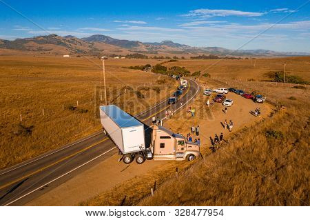 California Highway Traffic. Trucks And Cars On The Highway 1 Are Stuck Because Of The Accident. Huge