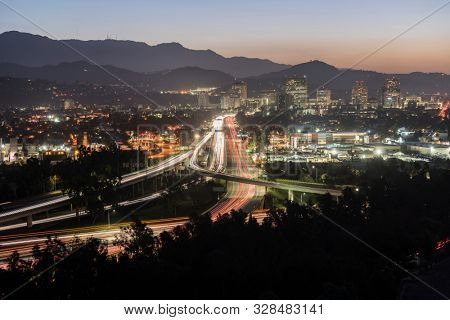 Dawn view of commuters on the Route 134 Ventura freeway in Glendale and Los Angeles, California.  Shot from Griffith Park looking east towards the San Gabriel Mountains.