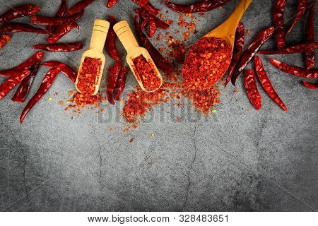 Cayenne Pepper On Wooden Spoon Spices And Dried Chilli Peppers Background / Group Of Red Hot Chilli