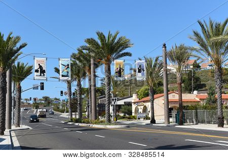 DANA POINT, CALIFORNIA - 18 OCT 2019: Banners hand over Pacific Coast Highway in the Southern Orange County Beach Town.