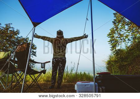 Travel Relax In The Holiday Camping On The Mountain. Young Woman Tourists Camping Relax On The Mouta
