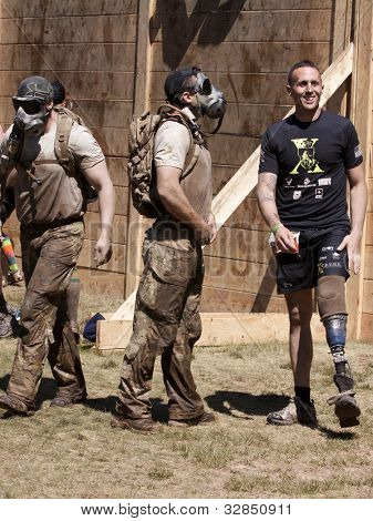 POCONO MANOR, PA - APR 29: Team members stand between the Berlin Walls obstacle at Tough Mudder on April 29, 2012 in Pocono Manor, PA.  The course is designed by British Special Forces.