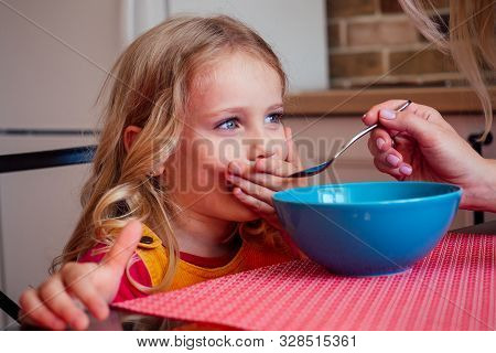 Beautiful Caucasian Girl Does Not Want To Eating Kitchen With Her Sister