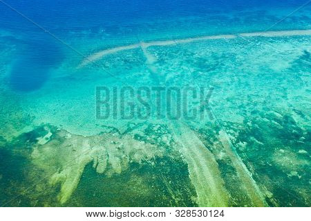 Background Image Of The Turquoise Sea. Deep Sea And Corals. Different Depths In The Sea.