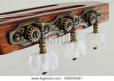 Close Up Of Tuning Mechanism On Classical Guitar
