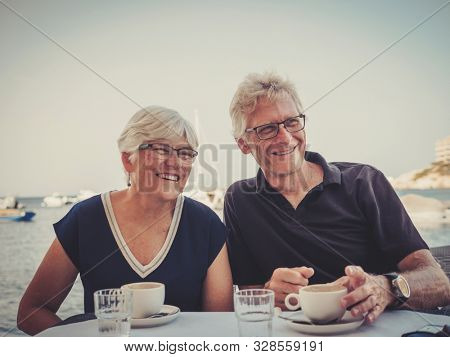 Retired couple enjoying coffee on a resort
