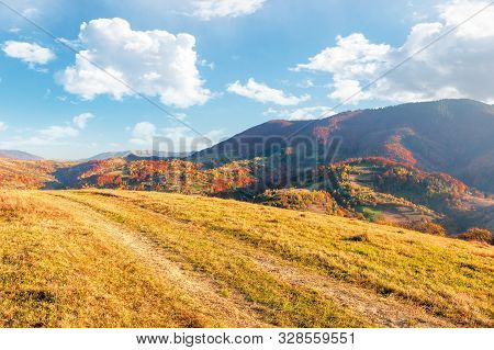 Beautiful Mountain Landscape In Autumn. Wonderful Sunny Afternoon Weather With Fluffy Clouds On The