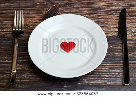 Waiting For A Favorite Dish In Restaurant Or Cafe. Heart On Plate With Fork And Knife. Lovers Meetin