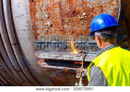 Worker Is Cutting Manually Old Metal Construction Using Gas Mixture Of Oxygen And Acetylene, Propane