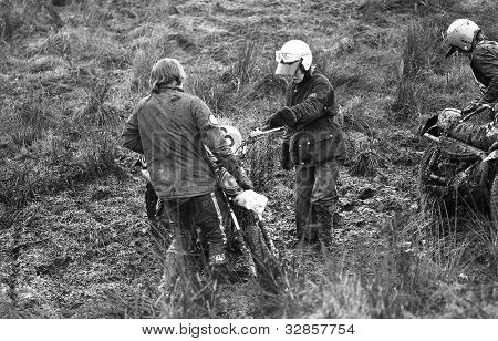 SUDBURY, ENGLAND - NOVEMBER 27: Unidentified competitors get stuck in mud during an Enduro race on November 27, 1977 in Sudbury, Suffolk. The sport involves timed stages on off road terrain.