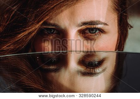 Woman Eyes Close Up Reflected In Mirror. Hypnotize Strong Look. Hypnotic Deeply Penetrating Glance.