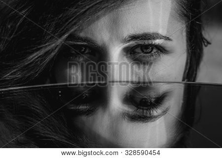 Woman Eyes Closeup Reflected In Mirror. Hypnotize Strong Look. Hypnotic Deeply Penetrating Glance. R