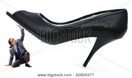 Woman domination concept with shoes and man